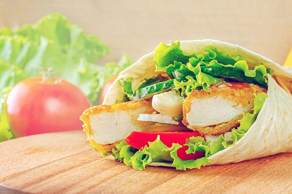 Chicken wrap with lettuce and tomatoes
